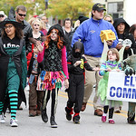 Students from Elyria Community School wave to people lining Broad Street. ANNA NORRIS/CHRONICLE