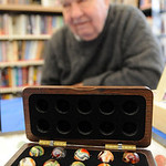 "Shoney ""Marbleman"" Webster of Brownhelm Twp, has been collecting marbles for over 60 years,  brought some of his collection for sale at the Hobby and Activity Day at Amherst Public Library o …"