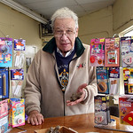 Norbert Dennerll, 83 owner of the Yellow Barrel of Magic on Cleveland St. in Elyria. He  holds one of the little piles of plastic dog poo that might qualify as a worthwhile April Fools Day p …