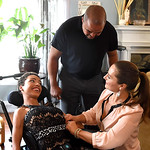 KRISTIN BAUER | CHRONICLE Ebony and Ingrid Wright, of Elyria, help their daughter Elna, 17, with a few last-minute touches to her outfit for prom on Saturday evening, May 7. Elna was going t …