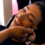 KRISTIN BAUER | CHRONICLE Elyria High School senior Elna Wright, 17, has her makeup done at her family home, in Elyria, by several members of her family before Cleveland Browns football guar …