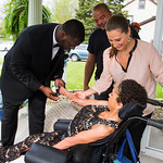 KRISTIN BAUER | CHRONICLE Ebony and Ingrid Wright, of Elyria, stand next to their daughter Elna, 17, on Saturday evening, May 7 as Elna had a corsage placed on her arm by Cleveland Browns' g …