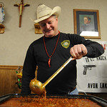 Avon Lake Police officer Tim Schleicher stirs up his Smokin' Gun chili at the Chili Coof Off benefit for Avon Police officer Pete Soto at Knights of Columbus Hall in Avon on Feb. 26.   Steve …
