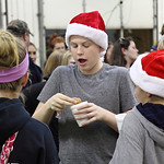 Mason Strader of LaGrange, age 12,  enjoys a donut and hot chocolate at LaGrange Christmas on the Square in the LaGrange Firehouse. photo by Ray Riedel.