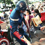 "ANNA NORRIS/CHRONICLE Superhero Captain America says hello to the audience as The Cleveland Pops Orchestra plays the Captain America March during their  ""Summon the Superheroes: Classical Mu …"