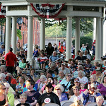 "ANNA NORRIS/CHRONICLE A large crowd listens to The Cleveland Pops Orchestra ""Summon the Superheroes: Classical Music to the Rescue–with a Bang!"" concert Saturday evening in Ely Square in do …"