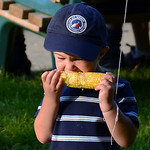 Will Hepner, 3, of Brownhelm Township, munches on an ear of corn on Friday evening.  KRISTIN BAUER | CHRONICLE