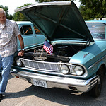 Larry Oldfield, of Elyria, stands next to his 1964 Ford Fairlane 500 during the car show on Saturday morning.  KRISTIN BAUER | CHRONICLE
