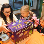 Christy Whalen, left, business manager, weighs candy brought in by Kylie, 7, and Samantha Klein, 5, of North Ridgeville, at the candy buyback at Dr. Scott Nagy's dental office in Elyria. Ste …