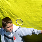 Joseph Cerrito, 6, of Elyria, sneaks around the large planet aboard the Elyria High School float. KRISTIN BAUER | CHRONICLE