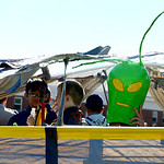 Ryan Gutierrez, 11, rides on the float for Avon Cub Scouts Pack 333 with his alien helmet. KRISTIN BAUER | CHRONICLE