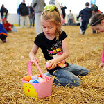 Hailey Lacko, 5, of Elyria, hurries to collect Easter eggs Saturday. KRISTIN BAUER | CHRONICLE