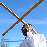 Bishop Peter Tower marches the cross into the Shiloh Baptist Church before their Sunday service.  KRISTIN BAUER/CHRONICLE