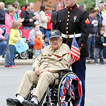 Lance Cpl. Bradley Formhals, back, pushes his great grandfather, Richard Vosburgh, a World War II Army Combic Medic veteran, along Broad Street in the Elyria Memorial Day Parade yesterday mo …
