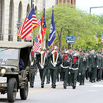 Members of the Elyria High School JROTC carry the colors as the group marches down Broad Street in the annual Elyria Memorial Day Parade yesterday morning. (CT photo by Anna Norris.)