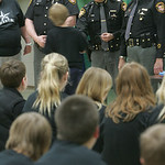 Lorain County sheriff's deputies Joe Greiner, left, Capt. Jim Drozdowski and Sheriff Phil Stammitti hand out diplomas and pins to about 50 Columbia Middle School fifth-graders who completed  …