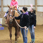 "Sophie Swabb, age 4, from Elyria, enjoys a horse ride with the assistance of volunteers during the Angels Haven ""Hoppin Around the Barn"" fund raising event at Evergreen Farm in Grafton. phot …"