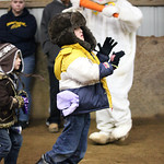 "Christopher Edmonds, age 8, passes by the Easter Bunny as he competes in a hopping race in the Angels Haven ""Hoppin Around the Barn"" fund raising event at Evergreen Farm in Grafton. photo by …"