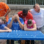 Jon Wysochanski, left, Bill Hudnutt, Shaun Bennett, Kevin Hill, Karie Spaetzel and Bruce Bishop react after completing the Ice Bucket Challenge. KRISTIN BAUER/CHRONICLE