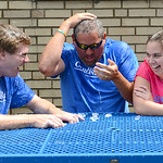 Jon Wysochanski, left, Shaun Bennett and Karie Spaetzel react after completing the Ice Bucket Challenge. KRISTIN BAUER/CHRONICLE