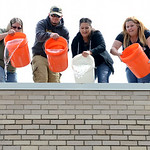 Marketing Director, Barb Ritsko-Stephens, Karen Rudisill, Dylan Bishop (son of chief photographer Bruce Bishop), Tasha Hohn, Jennifer Krafczinski and Amy McCrann drop buckets of ice water as …