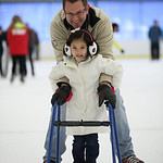 Ken Harp and his 5 yr old daughter Jie Jie enjoy the ice at North Park in Elyria. photo by Ray Riedel