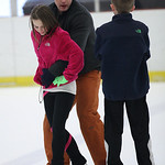 Cade Grant (11) of Avon listens while his coach, Patryk Szalasny from Poland, demonstrates a lift technique with Cade's partner, Lillie Dubena (11) of  North Ridgeville. Shown here at North  …