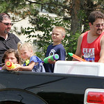 Members of Bethel Chapel IPHC cool off parade spectators by squirting them with water. ANNA NORRIS/CHRONICLE