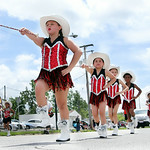 The Deputies baton corp marches in the parade. ANNA NORRIS/CHRONICLE