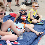 Gabrielle, 8, Zachary, 4, and Donovan Grudier, 6, of Penfield Township, watch the parade on Broadway on Sunday afternoon. ANNA NORRIS/CHRONICLE