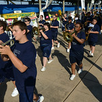 The Lorain High School marching band leads the way during the opening ceremony at the Lorain International Festival on Friday. KRISTIN BAUER | CHRONICLE