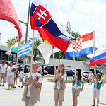 Girl Scouts carry flags representing various countries during the parade. ANNA NORRIS/CHRONICLE