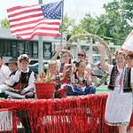 The Tatra Highlander Polish Polk Dancers wave to parade spectators as they ride on a float. ANNA NORRIS/CHRONICLE
