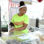 Tahlia Williams, of Lorain, serves pastries from Kiedrowski's Bakery in the Polish food booth at the Lorain International Festival on Saturday. KRISTIN BAUER | CHRONICLE