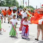 Member of El Centro Servicios Sociales, Inc. dress in traditional costumes as they walk in the parade. El Centro was the spotlight industry in this year's festival. ANNA NORRIS/CHRONICLE