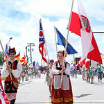 Members of the Polish Community carry the American and Poland flag in the beginning of the 48th annual Lorain International Festival parade in downtown Lorain Sunday afternoon. ANNA NORRIS/C …