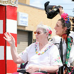 Members of the Hungarian community ride on a float. ANNA NORRIS/CHRONICLE