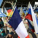 Lorain County brownies and girl scouts march into the Lorain International Festival carrying flags unique to many different nations celebrated at the festival on Friday. KRISTIN BAUER | CHRO …