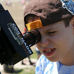 Justin Smith, 11, of Winter Park, Fla., looks through a telescope at Lakeview Park. ANNA NORRIS/CHRONICLE