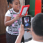 """Tatiana Fuentes of Elyria, age 7, is recorded as she recites the Poem """"Harriet Tubman"""" during the African American History Festival at Kanisa House in Elyria. photo by Ray Riedel"""