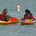 Don Safranek and Deirdre Garvey, both of Cleveland, meet in the waters off Lakeview Park.  photo by Chuck Humel