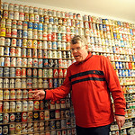 Lance Rice with his beer can collection at his home in Vermilion on Apr. 13.  Lance, who is autistic, is a beer historian and the dream of his film and book are gaining national attention.   …
