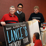 Lance Cole, left, with nephew Aaron Rice, and Tom Hug, hold a promotional poster for the Brewery Tour film to be made by Rice, at German's Villa in Vermilion on Apr. 13.  Steve Manheim