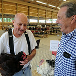 Keith Shay, left, and Tom Kelley, fair poultry experts, in the new poultry barn at Lorain County Fair on Aug. 21.  Steve Manheim