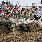 Mercedes Gecking, in the M13 car, smashes into Alex Goss in the junior class during the 69th annual Lorain County Fair demolition derby Sunday night. Kids ages 8-12 drove the cars accompanie …