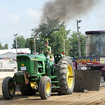 Brenden Casper, 13, pulls a John Deere 4010 tractor in his first tractor pull on Saturday morning. ANNA NORRIS/CHRONICLE