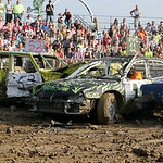 Two station wagons sandwich another car in the 1980's stock class during the 69th annual Lorain County Fair demolition derby Sunday night. ANNA NORRIS/CHRONICLE