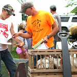 Rich Snyder, adult consultant for the Jr. Fair Poultry, right, helps Matthew Kovach, 13, of Amherst, left, fill out his paperwork for Kovach's two broiler chickens as he checks into the Jr.  …