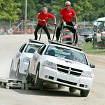 Two members of the Black Cat Hell Drivers ride a top two Dodge Avengers in a precision driving stunt during the Black Cat Hell Drivers show at the Lorain County Fair Sunday afternoon in Well …
