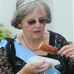 2014 Senior Queen Karen Farmer of Avon Lake has a corn dog at Lorain County Fair. She was nominated for the queen contest by Meals on Wheels.  STEVE MANHEIM/CHRONICLE